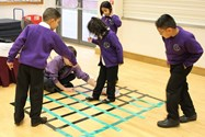The children help each other with the Matrix challenge