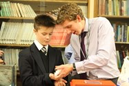 Mr Teasdale passes a mouse to one of the Year 7 boys