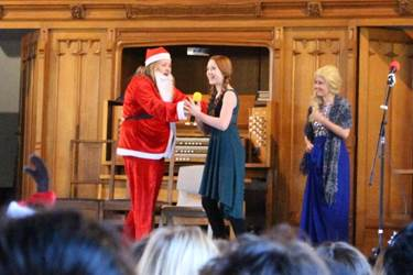 Father Christmas refuses to build a snowman, despite Anna and Elsa's best efforts