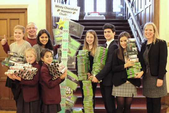 Some of the pupils involved, with Dave Bagley, Mrs Entwistle, and the giant fundraising gauge!