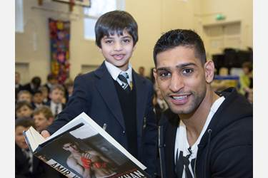 Amir Khan tells boys to chase their dreams