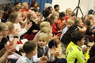 An audience full of delighted faces as the children enjoy the show