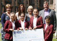 Year 7 girls present a cheque to Sam Allardyce, patron of One Step