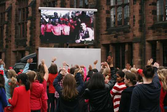 Tanzanian Kindergarten children sing their thank yous via Skype