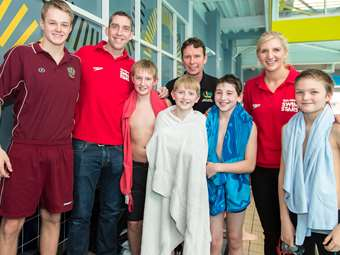Rebecca and Steve with the Junior Boys' Swimming Team