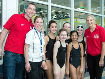 Rebecca and Steve with the Junior Girls' Swimming Team