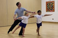 Michael helps two pupils perfect their balance