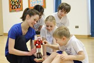Emily shows some of the children the Nutcracker used in a performance