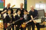 Pop Project performers Malcolm, Graham and Henry with some of the Junior Boys
