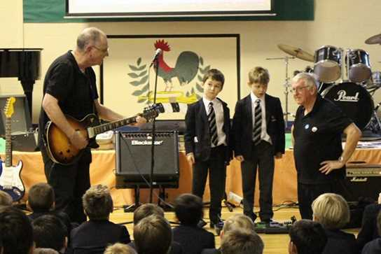 Two boys help to demonstrate the effect of different guitar pedals