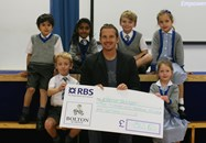Beech House pupils presented a cheque to Bolton Wanderers Captain Kevin Davies