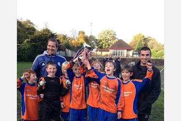St Johns Bromley Cross receive their trophy from Bolton Wanderers captain Kevin Davies
