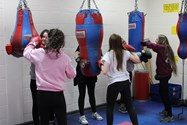 The girls try their hands at boxing