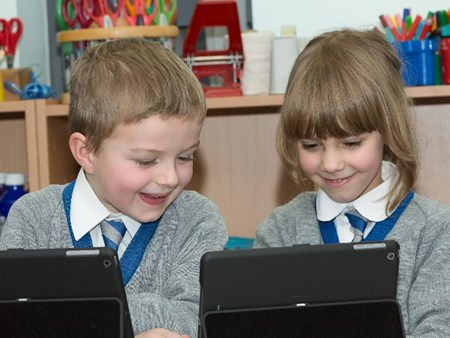 Two pupils using the iPads