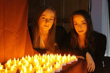 Alexandra and Sarah with the memorial tea-light display