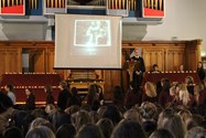 Students entered the Great Hall carrying tea-lights to be placed in a memorial display on the stage