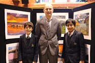 Sam Olawumi and Arsh Patankar with Mr Dickinson at the exhibition