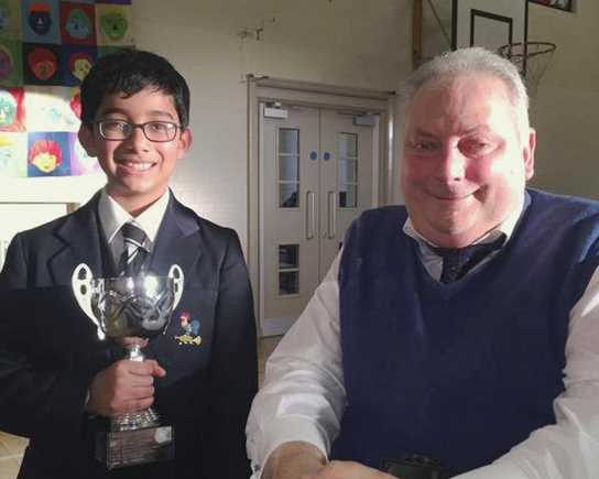 The trophy was presented to Anuj by adjudicator Mr Eastham
