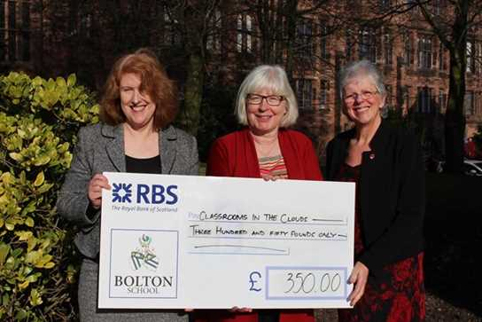 Dr Sheila Fisher (centre) accepts the cheque from Headmistress Sue Hincks and OGA Secretary Ann Evans