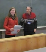 Prof. Bradford presents Annabel with the certificate