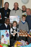 Babu Roye, Bill Laithwaite and other Bolton Lions receive a wonderful selection of gifts from the children of Beech House