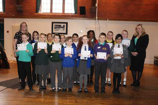 Pupils representing 14 schools are photographed here with their certificates of achievement