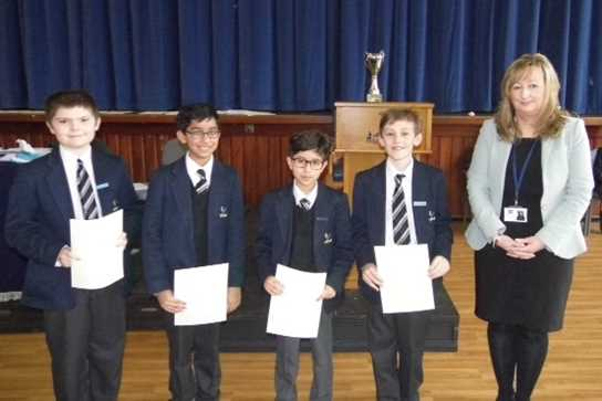 The team were presented with their second place certificates by the AJIS Quizmaster