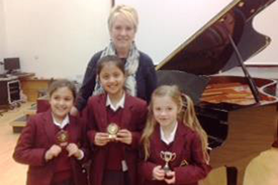 The winners of the Year 3 Piano competition with Mrs Hilton
