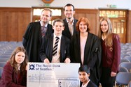 Senior Girls and Boys presented Max with a cheque during their joint assembly