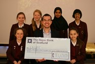 Junior Girls presented Max with a cheque during their joint assembly