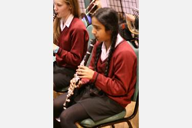 Vasudha playing with the Bolton School Concert Band