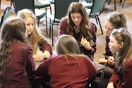 A group of girls discuss the Oscar Pistorius evidence during the criminal case workshop