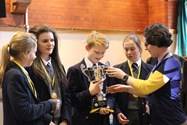 Dr Wheatland presents the trophy to Kirkham Grammar School