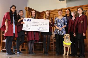 Girls' Division pupils present their cheque to Andrea