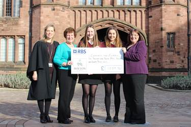 Mrs Sophie Entwistle, Maisie Kennedy and Molly Marshall present the cheque to Joan Anderson and Gwen Lightfoot