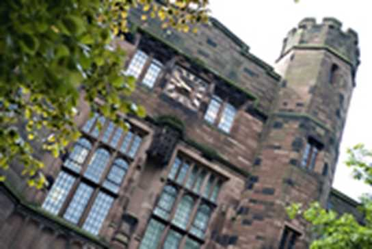 Photo of Bolton School exterior and clock face on the building