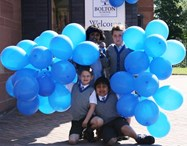 Pupils celebrate entering their new school