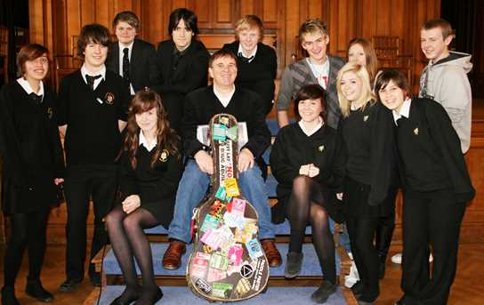 Pupils from local secondary schools and Chris Difford