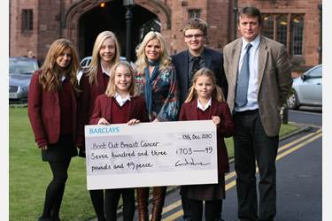Pupils present the cheque to Debbie Dowie