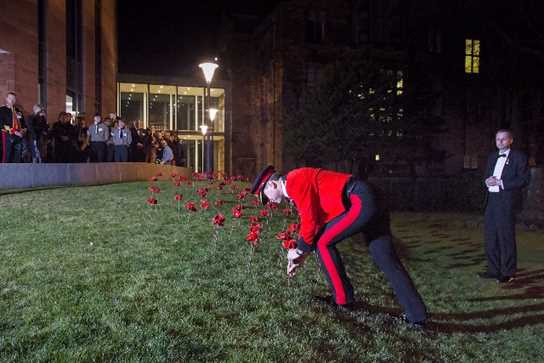 Major General Skeates planting the final poppy at the ceremony