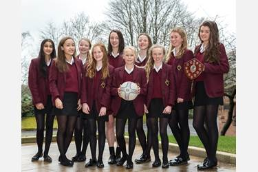 The U13 team with the Bolton Schools' Netball trophy