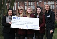 Girls present cheque to North West Air Ambulance
