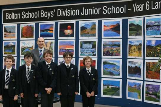 Year 6 boys and Mr Dickinson proudly exhibit their landscape pictures