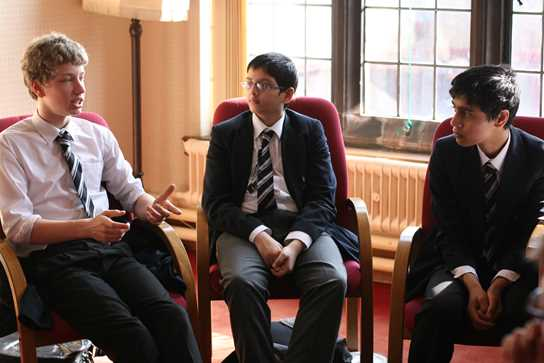 Year 9 Ainsworth boys in discussion with the Headmaster