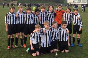 The U12 Football Team after winning the Town Cup