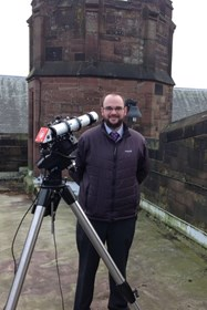 Mr Ickringill on the Turret Library roof with the Ogden Trust