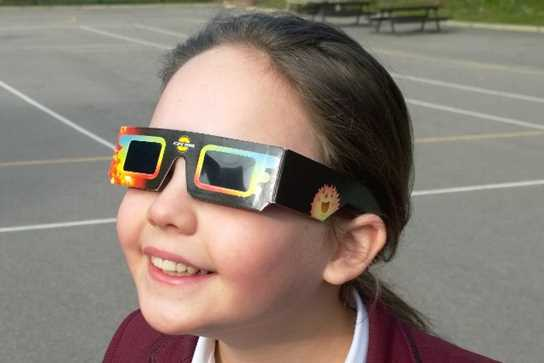 Wearing 'eclipse viewer' glasses