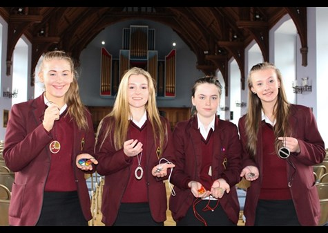 Sasha Cooke, Jess Stiles, Rosemary Somerville and Ellie Addison with a selection of the pewter pendants