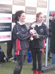 Captains Sophie Bolton and Tessa Pendlebury receive the National Schools