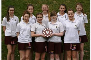 The U13s team proudly display their winners' shield